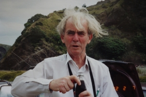 "This is my all-time favourite foto of dad: on holiday, wind-blown hair, his hairy eyebrows, his trusty binoculars, that quizzical ""who-me"" look. The ultimate free-spirit."