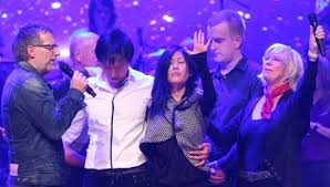 """""""Doctor"""" Phil Pringle (left), his wife Chris Pringle (right), and other C3 Pastors paying for Kong ehe and Sun Ho."""