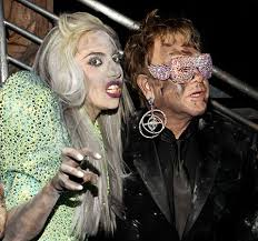Elton out with a transexual. Welcome at all Hillsong churches. Can camp there.