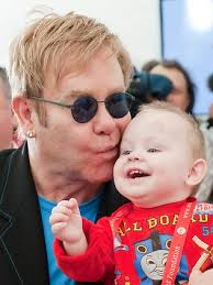 Elton. Love children. Happily gay like Brian like them.
