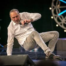 Brian Houston has a paunch. Brian showing how to move like a sea lion turning over on the beach while preaching the Hillsong Money Cult gospel.