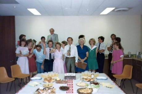 Frank Houston celebrating his birthday with Christian Life Centre staff in the early 1980s. Peter Laughton, who Frank Houston was having a homosexual affair with his the young man to the left of Frank's wife Hazel.