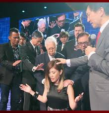 Kong Hee and other Harvest Church leaders handing over Harvest Church to Sun Ho's leadership.