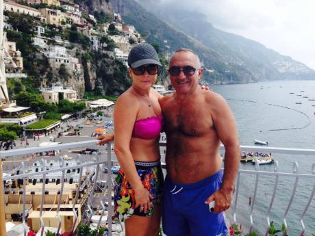 Pat Mesiti with second wife Andrea in Positano Italy. On holiday with their close friends Bobbie and Brian Houston.