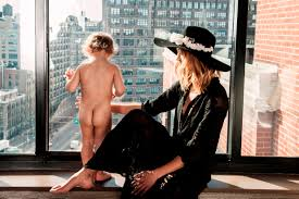 Esther with little houstin son. Is it wise to post this photograph of your son on-line naked like this. Has esther heard of peophiles? Her husbands granddad was one.
