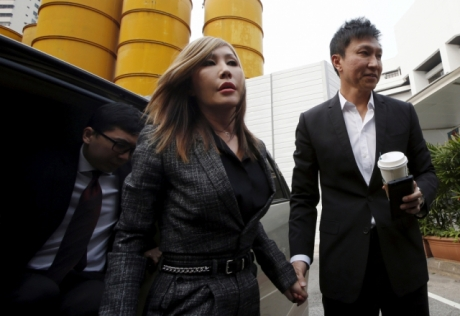 (Photo: Reuters/Edgar Su)City Harvest Church founder Kong Hee (R) and his wife Sun Ho, also known as Ho Yeow Sun, arrive at the State Courts in Singapore, October 21, 2015, where a verdict is expected to be delivered for their trial of misappropriating S million (.5 million) of church funds and falsifying the church's accounts.