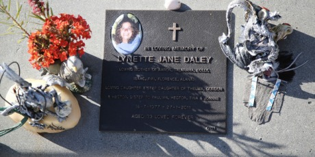 Flowers and mementos adorn the grave of Lynette Daley, in Maclean, Australia.